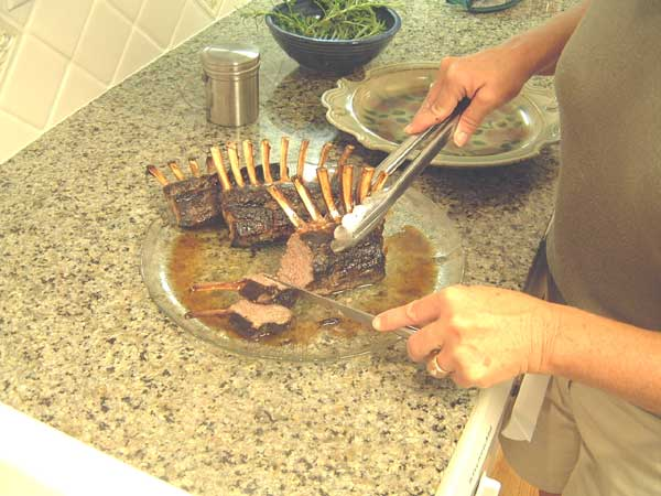 Slice meat between rack of lamb bones