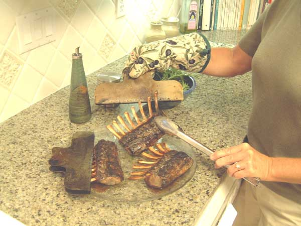 Remove bonetector from rack of lamb using a pot holder or rag -- Caution: Very Hot!