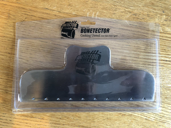 Single Bonetector in packaging on kitchen table